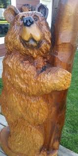 large wood carvings large chainsaw carved standing by post mountain peaks