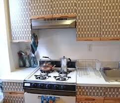 kitchen cabinet upgrade upgrade kitchen cabinet doors apply wallpaper on the doors