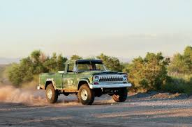 jeep j truck jeep j truck driving through dirt photo 79428308 hopping up an