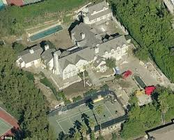 tom cruise mansion tom cruise and katie holmes divorce settlement who will get what