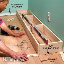 install cabinets like a pro the family handyman how to install kitchen base cabinets