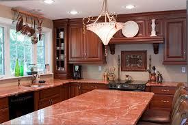 granite countertop white kitchen cabinets and backsplash green