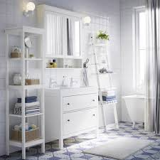 a white bathroom with hemnes washstand shelf and mirror cabinet
