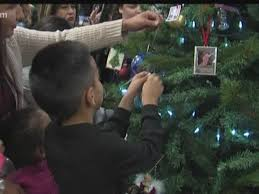 tree of awaiting ornaments representing lost loved ones