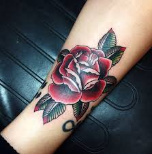 traditional deep red rose tattoo by andy revenant tattoos by