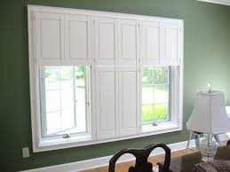 decorating charming window with white levolor blinds on olive