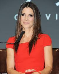 sandra bullock 49 flashes a smile as she stuns in a figure