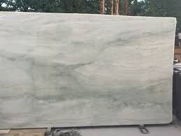 what cabinet and wall color with sea pearl quartzite