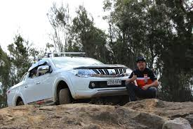 triton mitsubishi accessories australian off road champion toby price takes to four wheels in