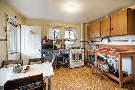pass through kitchen window smooth white wooden countertop sleek