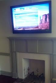 100 where to place tv tv above a fireplace in a 100 year farm house yep we can do