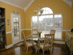 traditional dining room with chair rail u0026 high ceiling in munford