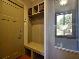interior micro mudroom design idea with grey beadboard and white