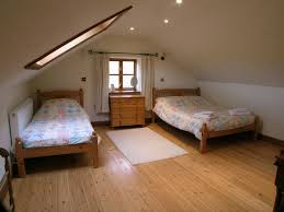 Unfinished Laminate Flooring Sharing Attic Bedroom Design With Unfinished Two Single Bed Drawer