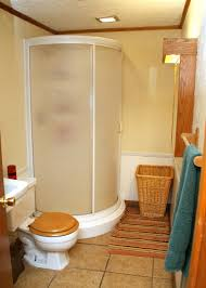 Corner Shower Stalls For Small Bathrooms by Inviting Small Bathroom Scheme Showcasing Corner Curve Shower