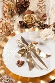 beautiful and elegant gold place setting for christmas or