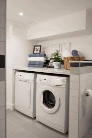 laundry in bathroom white wooden sink cabinet amber wooden wall