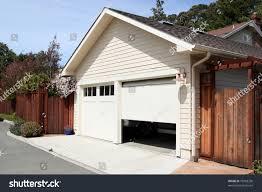 Garage House by Open Garage Door Suburban House Stock Photo 78983230 Shutterstock