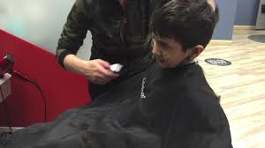 4 year old getting his first professional haircut haircut at