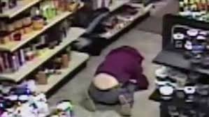 floor in jumps on floor in crouched position after robber bursts in