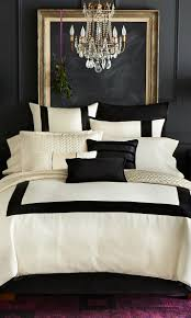 luxury black and white bedroom with crystal chandelier and linen