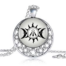 awen celtic druidic symbol pendant moon and sun photo