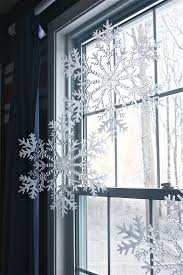 plastic snowflakes from dollar tree hung from curtain rod with