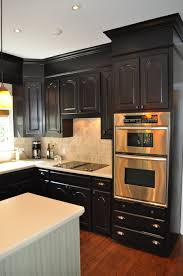 dark kitchen cabinets with light floors and kitchen island