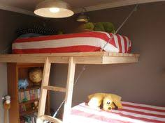 Bunk Beds Suspended From The Ceiling And Attached To The Studs In - Suspended bunk beds