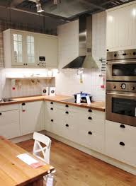 some smart ways to create a small kitchen design homesfeed elegant brown picket countertop plus behind range the prime backsplash along wooden floor small kitchen design