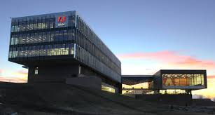 adobe shares rise on strong revenue fortune