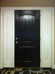 black front door with shutters on side lights outside