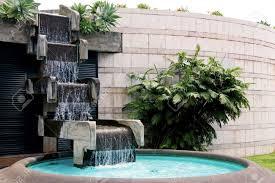 lawn garden exterior grey natural stone backyard waterfall