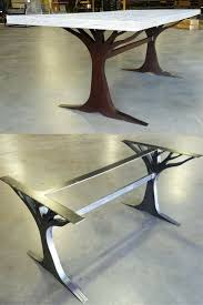wood table with metal legs what an interesting custom table leg base made from metal love the