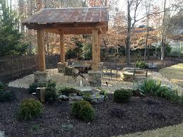 fire pit cazebo and gravel patio forsyth landscape