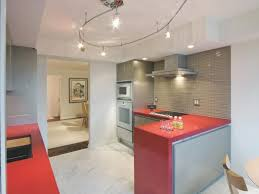 Create A Luxurious And Modern Kitchen Backsplash Modern by Marble Flooring Glossy Orange Countertops Bold Color Kitchen