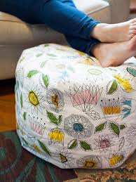 ottoman with patterned fabric how to make a fabric pouf ottoman hgtv
