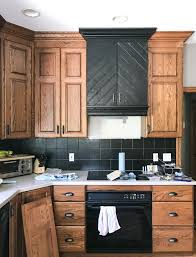 what color backsplash with honey oak cabinets how to make an oak kitchen cool again copper corners