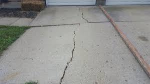 concrete driveway sinking repair post winter woes should i repair or replace my crumbled and cracked