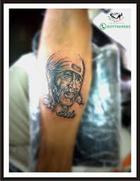 tattoo text arm sai baba face with om sai tattoo on arm by samarveera2008