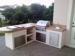 corner outdoor kitchen island with stove and stainless steel sink