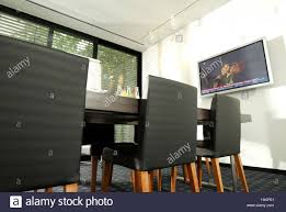 meeting room conference table flat screen tv window front stock