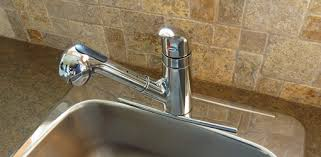 replacing kitchen sink faucet how to install a kitchen sink faucet today s homeowner