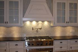 mini subway tile kitchen backsplash traditional kitchen style with white cabinets and subway tile