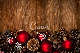 tree ornaments in snow photos by canva
