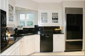 kitchens with white cabinets and black appliances black kitchen appliances modern curtain concept for black kitchen