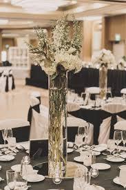 reception décor photos tall centerpiece vase inside weddings