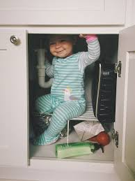 kitchen cupboard door child locks how to baby proof your cabinets parent guide