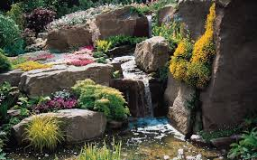 large backyard landscape design with low stone waterfall ponds