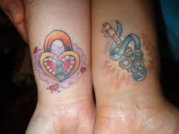 red and blue lock key couples tattoo tattoomagz